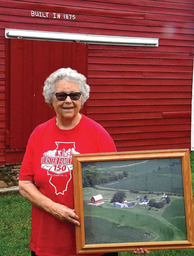 """The granary on the Wurster farm is the oldest building still in place, marked with a """"Built in 1875"""" sign that's been repainted through the years. Marilyn Wurster holds an aerial photograph of the farm that was taken a few years ago. Inset; Marilyn Wurster at the Wurster rock at the end of the driveway with her sons, Tim, left, and Tom."""
