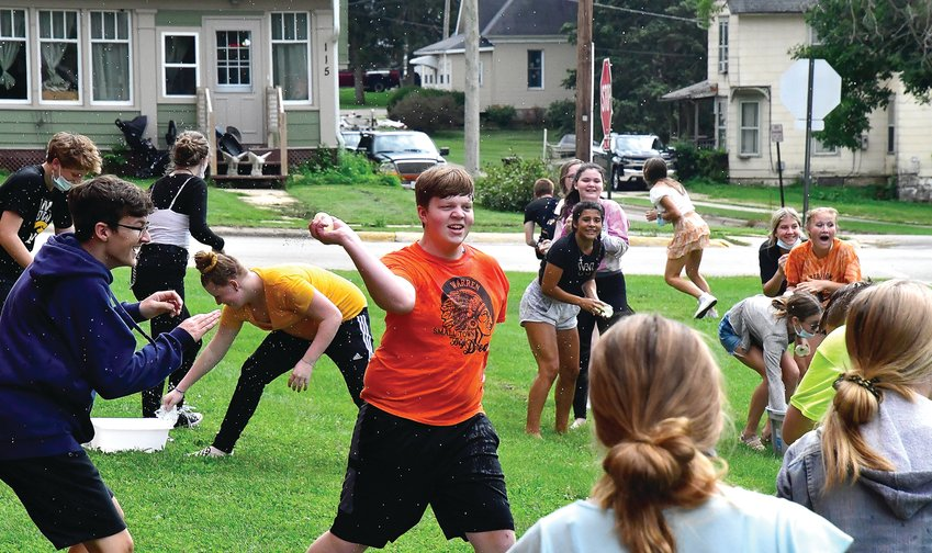 Bentley Euler, center, hurls a water balloon at a classmate as Warren celebrated its version of La Tomatina on Wednesday, Aug. 25.