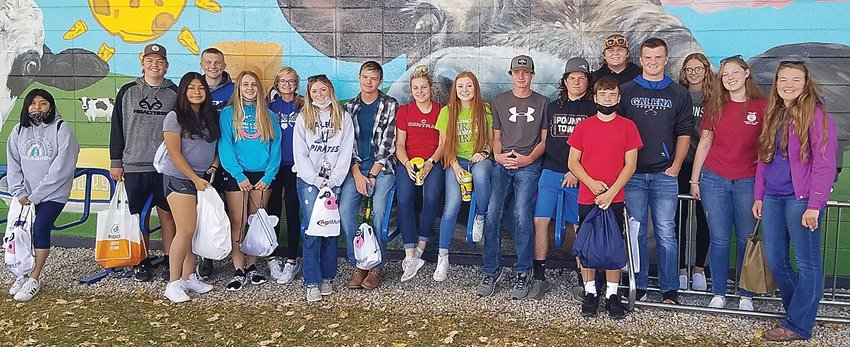 """On Sept. 28, a group of Galena High School animal science students and FFA members traveled to the World Dairy Expo in Madison, Wis. Luke Duggan, Cooper Einsweiler and Tyler Temperly, competed in the Dairy Products career development event. They had to sample cheeses, milk and other dairy products to identify them and/or determine if there are flaws. Temperly said, """"We had to find problems with some milk and it was interesting. When cows get into garlic you can really taste it. It was super cool."""" They placed 40/62 as a team with Einsweiler leading the team score. Aly Anderson, Landon Casper and Sami Deininger competed in the Dairy Cattle Judging competition. They had to evaluate dairy heifers and cows based on their structure and udder. They placed 46/8 as a team with Anderson leading the team. Freshman Landon Casper said he """"learned a lot."""" The rest of the day consisted of trying the famous grilled cheese from the Badger Dairy Club while exploring the expo, networking with agricultural professionals and watching cows from all over competing in the show ring. Sophomore Blaine Timmerman said while networking, he thought it was fun """"collecting all the company bags. I found it fun and saw lots of companies that way."""" From left: Perla Perez, Tyler Temperly, Mafe Lopez, Cooper Einsweiler, Mikayla Knautz, Olivia Richardson, Paige Monahan, Cody Monahan, Gwen Hesselbacher, Kiera Lyden, Luke Duggan, Ryan Stoffregen, Blaine Timmerman, Landon Casper, Carson Miller, Taylor Jones, Sami Deininger and Aly Anderson."""