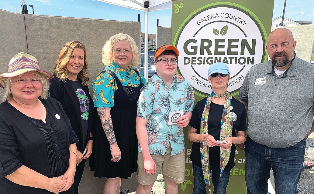 The Galena Country Green Designation Committee recently recognized four new businesses with the green business designation at the Electric Vehicle Showcase and Test Rides Saturday, Sept. 14 in Galena. The green designation is given in the categories of lodging, retail, professional and restaurants for the concern for the environment and for the sustainable measures businesses practice. From left, Hendrica Regez, Galena Country Green Designation Committee; Amanda Tippett, general manager of Thriving Thistle; Catherine and Brandon Kouzmanoff, Galena Juicery and Meal Prep, Inc.; Pam Bernstein, committee member; and John Scott, Jo-Carroll Energy.