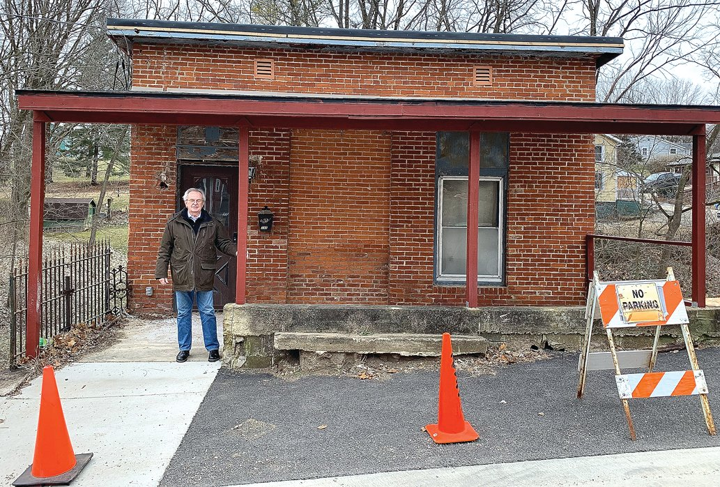 Ken Robb, president of The Galena Foundation board, stands in front of the brick and stone house at 348 Gear St. Through a donation and purchase agreement, the foundation recently acquired the house, which is in need of extensive restoration work.