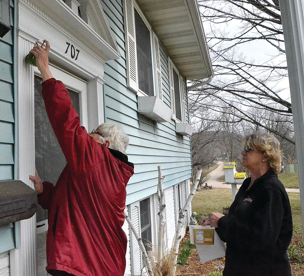 On Friday, March 27, Lay Pastor Jeanne Ohms of Hanover United Presbyterian Church, left, blessed Patsy Geiger's house in Hanover with a mixture of virgin olive oil, oil of Frankincense and myrrh, while Lorraine Speer assisted.