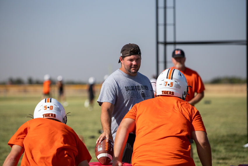 Mangum Head Coach Sam Powers works with his linebackers and defensive line Monday.