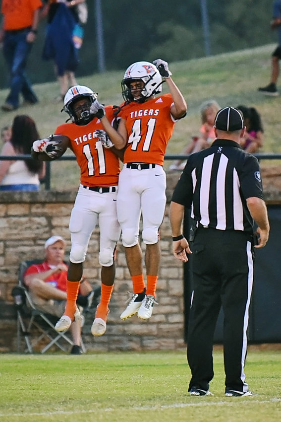 WR Lamar James, left, and WR Jaiden Shandy celebrate a touchdown in Friday's win against Apache.