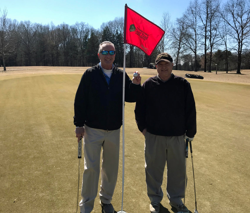Anthony S. Puca (left), standing with Phillip Naron, is all smiles after recording his second career ace on Saturday at Henry Horton.