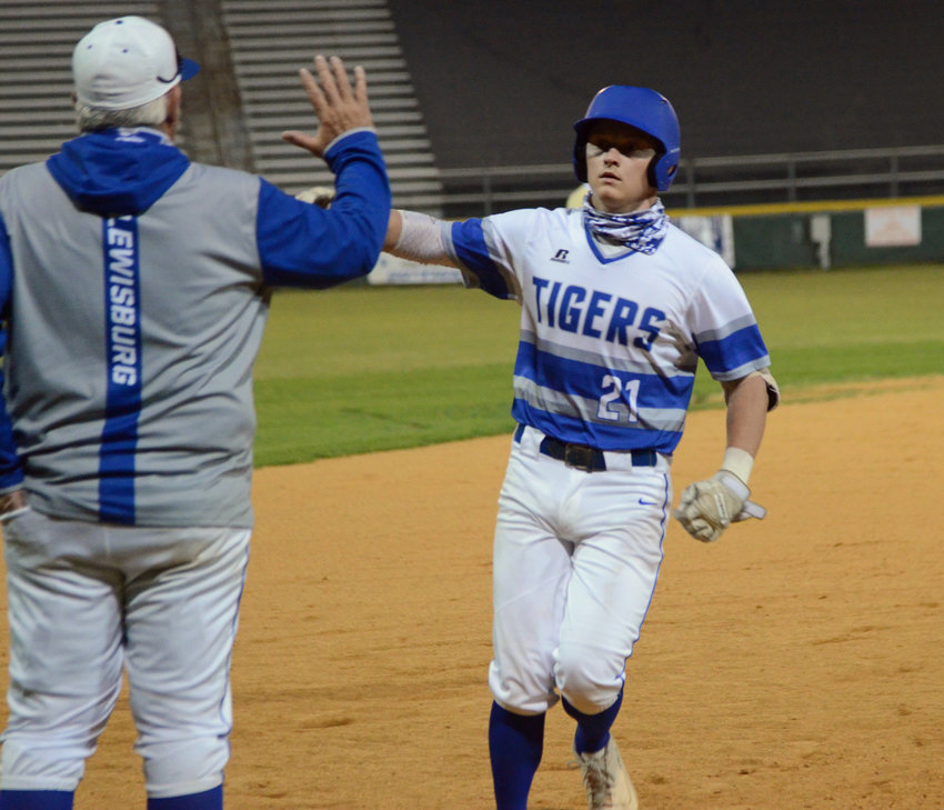 """Grayson Miller does the home run trot and gets ready to touch the third base bag where MCHS coach Mike """"Monk"""" Reese is waiting for the high-five for Miller in the bottom of the sixth inning."""