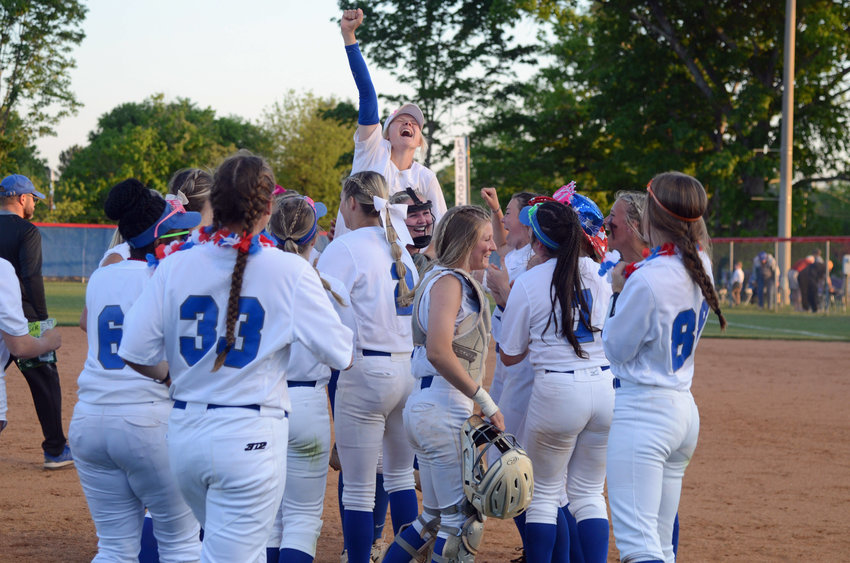 Laura Mealer gets a ride from Ashley Milligan as the Lady Rockets celebrate winning the district title.