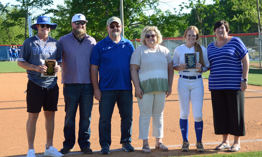 The Chad Franklin Award was handed out before the District 12-AA title game Thursday night at the Field of Dreams in Chapel Hill and from left are, award winner Max Kirby, Brad Franklin, Kevin Franklin, Rhonda Franklin, award winner Jenna Blanton, and Forrest principal Angie Phifer.
