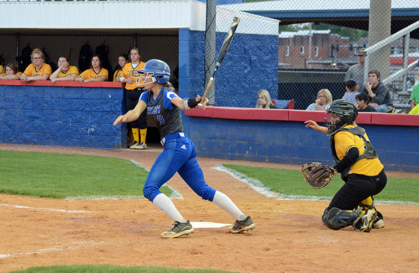 Karley Daughrity drills the game winning, walk off single in the bottom of the fifth inning for the Lady Rockets, who run-ruled Camden 10-0 in the Region 6-AA Tournament opener at the Field of Dreams in Chapel Hill Monday night.