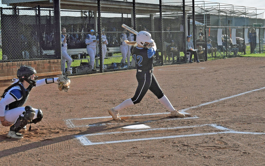 Marshall County's Ellie Luce drills a two-run double in top of the third inning that gave MCHS a 3-0 lead at Nolensville last Wednesday in the District 12-AA loser's bracket final.