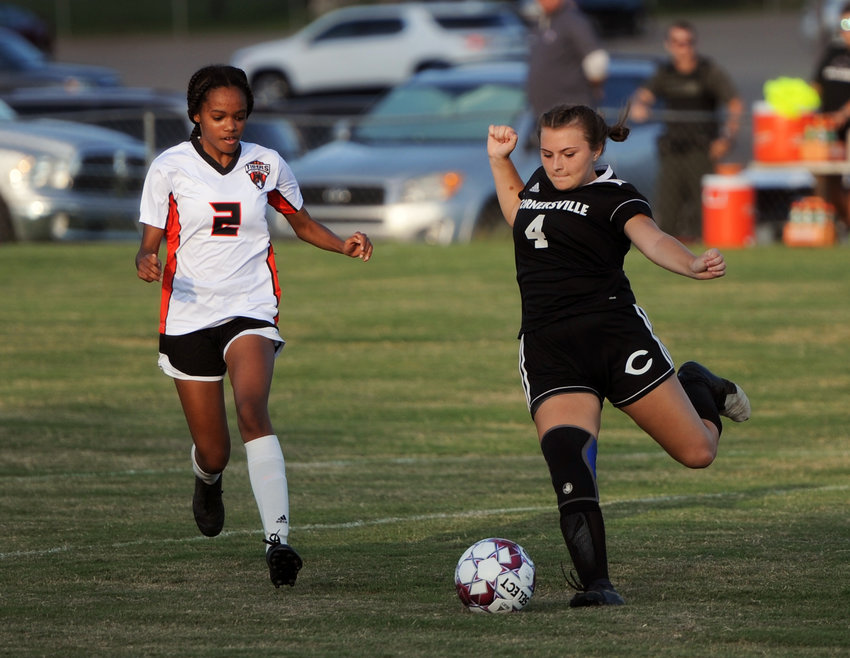 Mia Gross battles a Fayetteville defender and pushes the ball into the Lady Tiger end of the field.