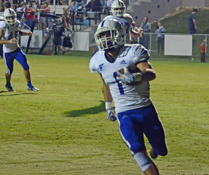 Rocket senior Chris Davis (1) scores the first of his two touchdowns in Forrest's 21-7 win at Moore County Friday night.