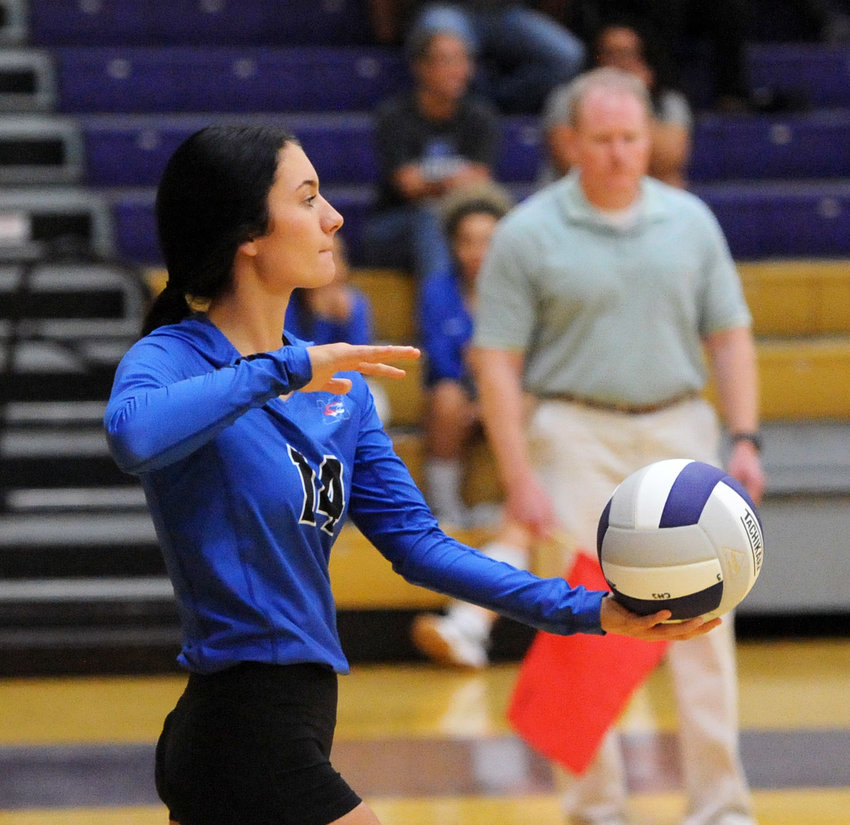 Mallorie Wooten delivers a serve in the first set against Community on Tuesday night. The Tigerettes fell to the Viqueens, 3-0.