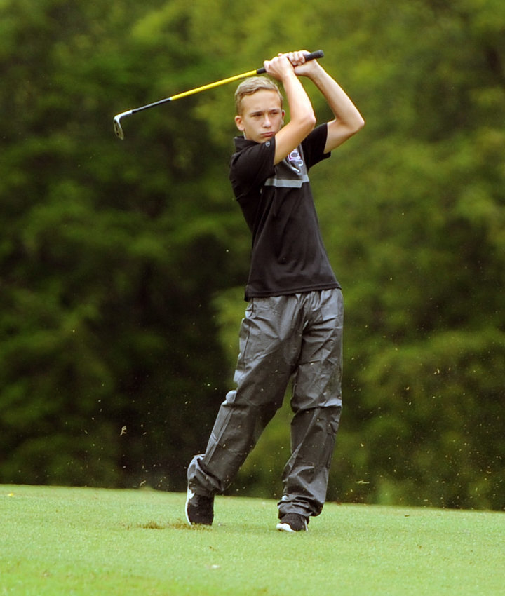 Brax Hunter watches his approach shot on Hole 3 during Monday's district golf match at Henry Horton.