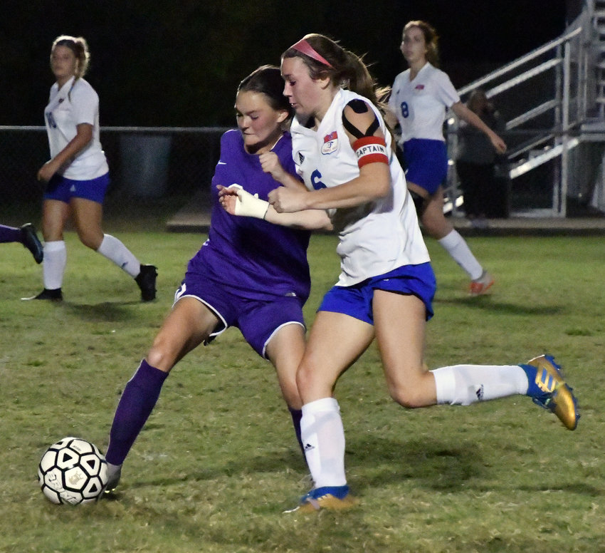 Sarah Woolbright (2) of the Viqueens and Addison Bunty (6) of the Lady Rockets battle for possession.