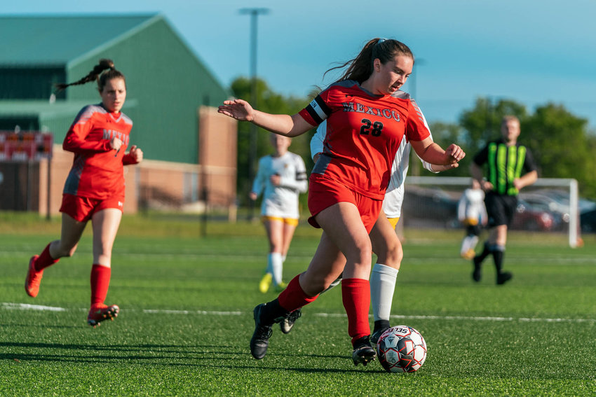 Senior Miriam Gleeson looks for open space as Maddi Maxwell hustles to give support. [Eric Mattson]
