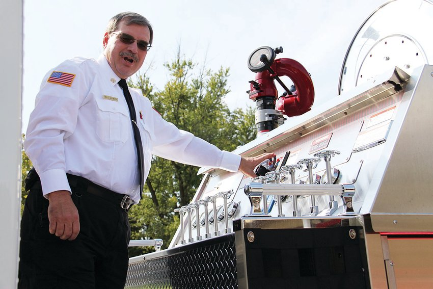 Little Dixie Fire Protection District Chief Bill Albus points out some of the electronic features on the district's new fire truck. LDFPD firefighters average 400 calls per year, ranging from injuries to blazes. [Dave Faries photo]
