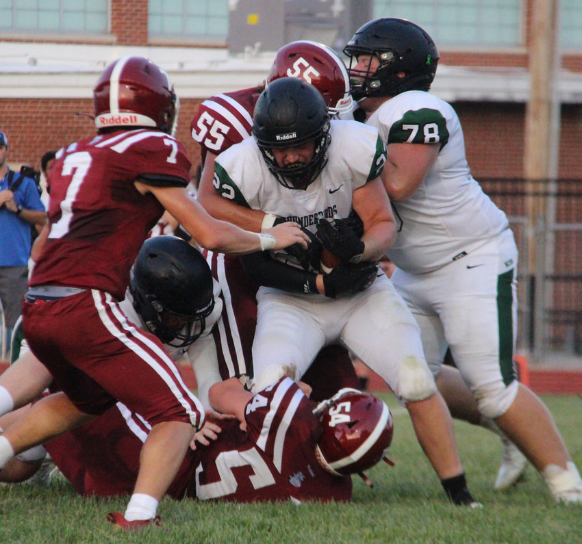 Trevor Ray meets resistance from the Louisiana defense as teammate Brandon Speight helps push the pile [Nathan Lilley].