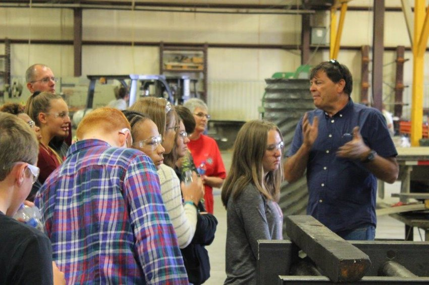 Mark Korman leads a tour of Fluid Power Support. The company was honored with the Commerce and Industry Award. [Submitted photo]