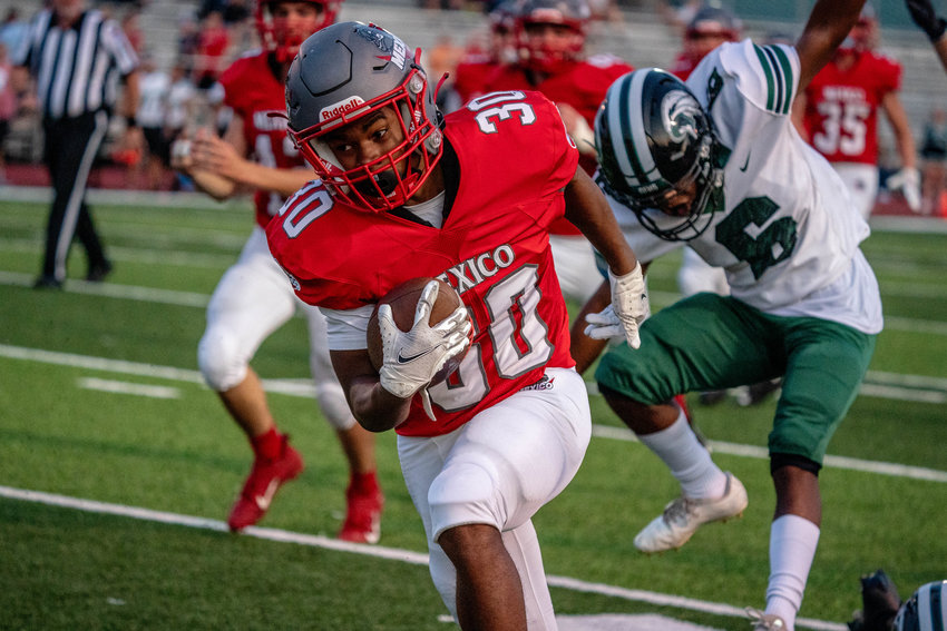 Anthony Shivers races down the sideline for one of his four touchdowns on Friday night in Mexico's 42-6 romp. [Eric Mattson]
