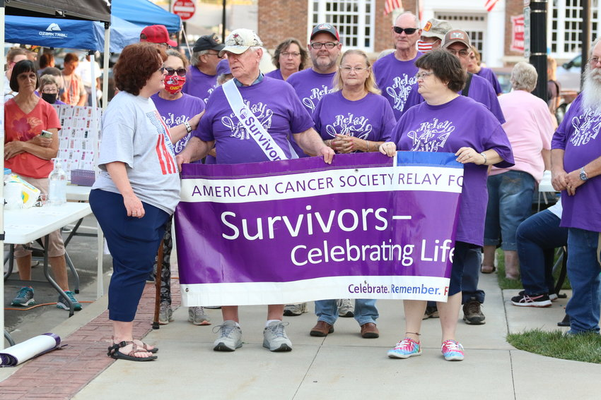 Cancer survivors gather before taking a lap around Mexico's square during Relay for Life ceremonies on Saturday. The event raised more than $22,700. [Dave Faries]