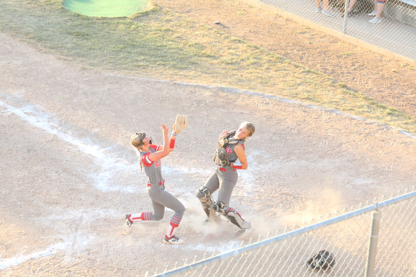 Jordyn Thurman calls for the ball as catcher Karlee Sefrit steps aside during the Bulldogs' extra inning win. [Dave Faries]