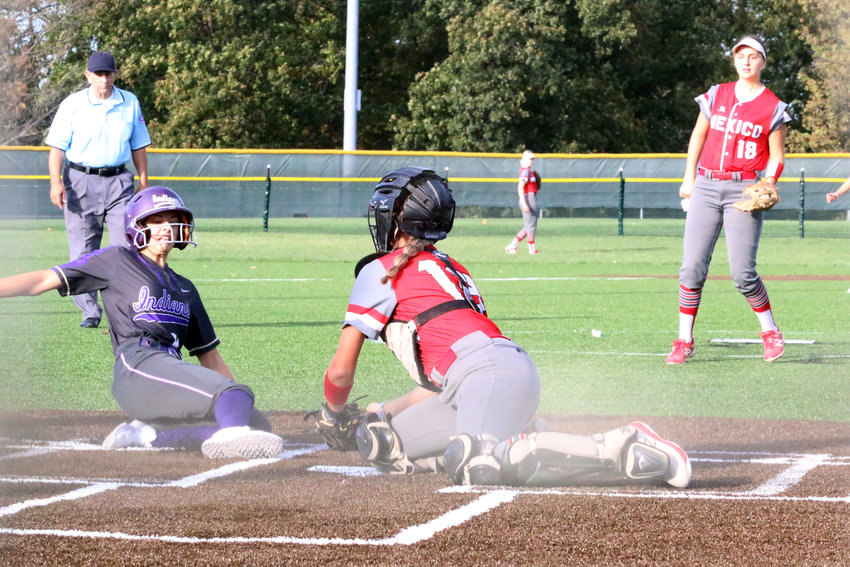Mexico catcher Karlee Sefrit tags out Avery Oetting at home in the bottom of the first inning Wednesday. Kierstan Epperson is in the background. [Nathan Lilley]