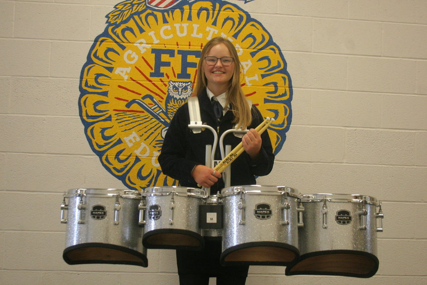 Montgomery County junior Cora Johnson poses with her drums at Montgomery County High School. She was selected to play tenor squad and concert percussion in the National FFA band on Oct. 27-30 during the National FFA Convention & Expo in Indianapolis, Ind.