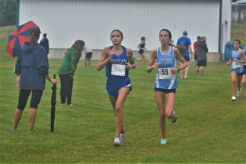 Montgomery County junior Lyric Ford battles with Tolton Catholic's Elyse Wilmes for first place in the girls race of the New Haven Invitational on Sept. 4. Ford, who won last year's individual title, placed fourth.