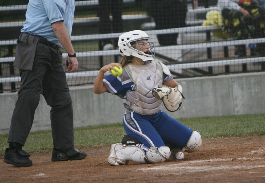 Montgomery County sophomore Maddy Queathem tosses a ball while playing catcher in the Wildcats' home finale against Louisiana on Sept. 30. She replaced her older sister, Sam, behind the plate after a season-ending injury the week before.