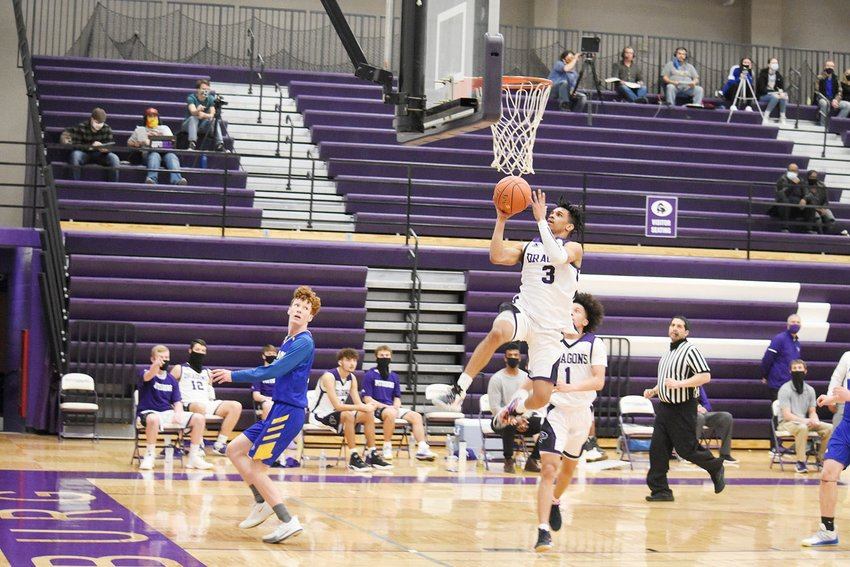 Pittsburg's Javon Grant rises for a layup in Pittsburg's 71-63 home win over Parsons during the regular season.