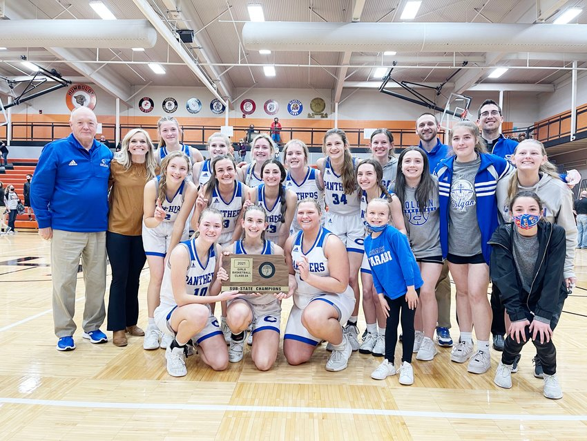 The St. Mary's-Colgan girls varsity team poses with their 2021 sub-state championship plague. Head Coach Abby Farabi was named the Sports in Kansas Class 2A Coach of the Year on Thursday.