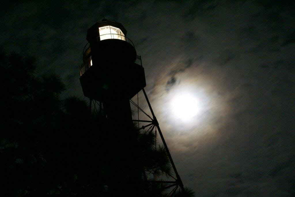 Crooked River lighthouse and moon