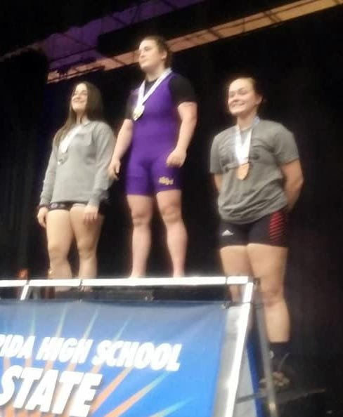 Wewa senior Landin Johnson, right, receives her third place medal at state in the 169-pound division