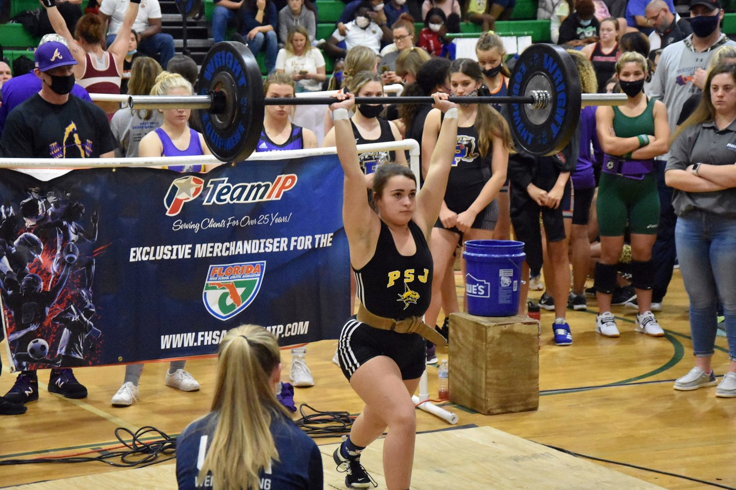 Port St. Joe senior Gabby Nicodemus performs a clean-and-jerk at state