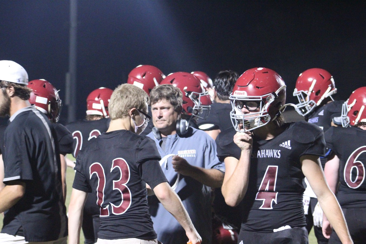 Coach Dirk Strunk huddles with his players during the Cottondale game