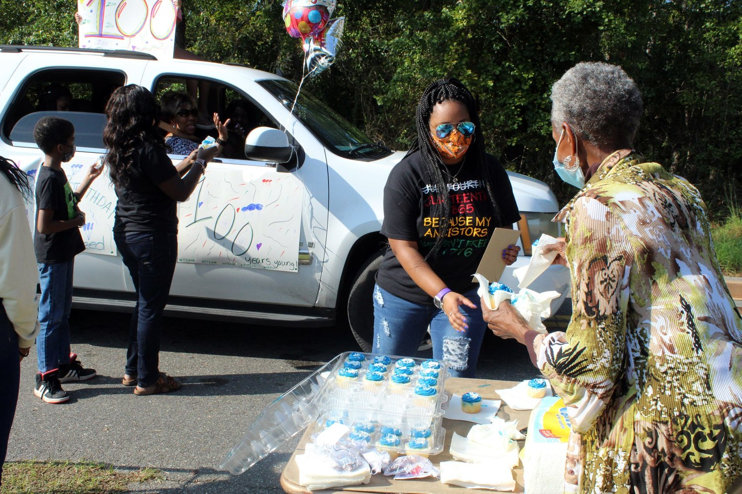 The Speed family handed out cupcakes to the procession of vehicles.