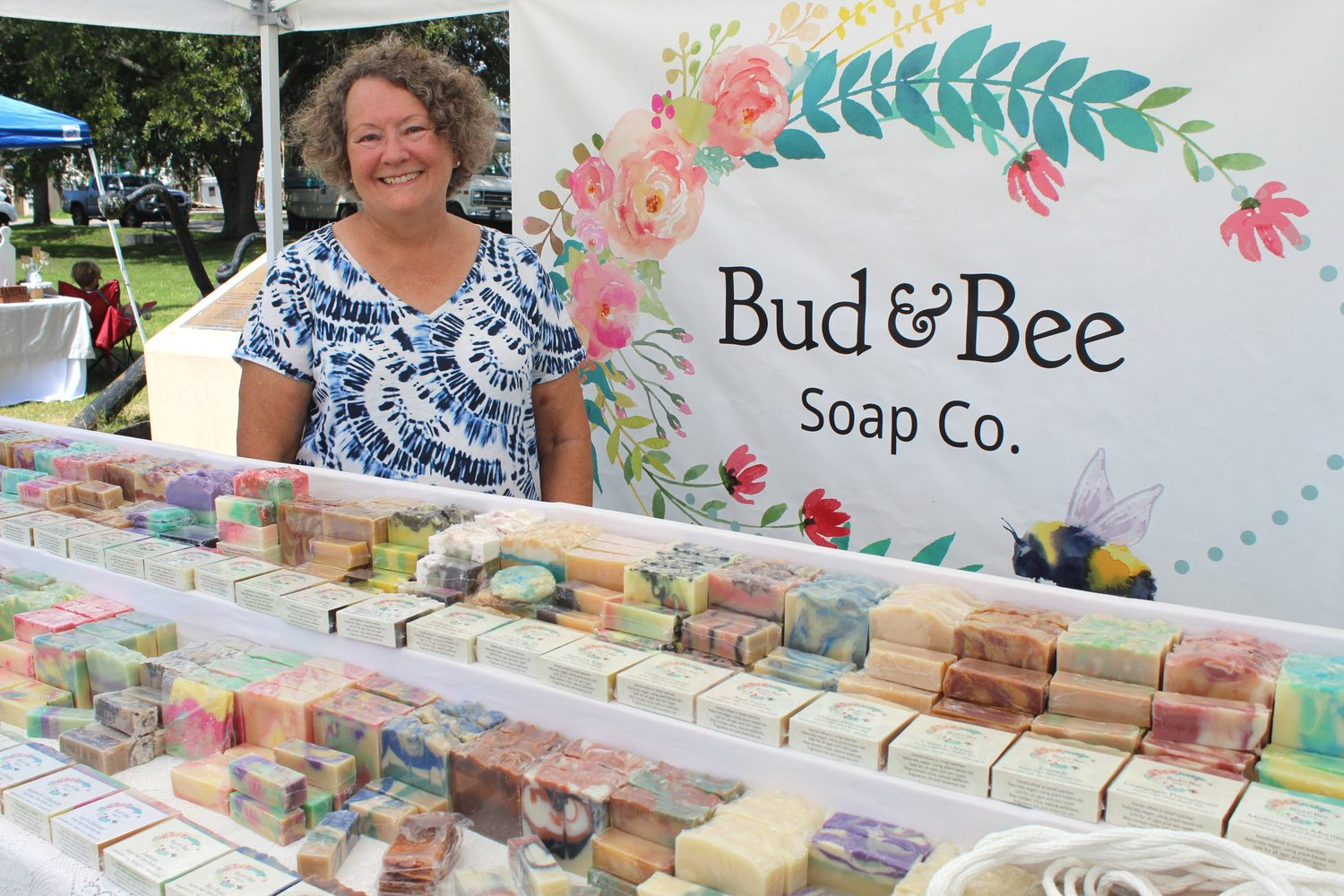 Eastpoint's Linda Carroll, with the Bud & Bee Soap Co., stands with her display of handmade soaps. She will be at the Eastpoint Artisan and Farmers Market this Saturday.