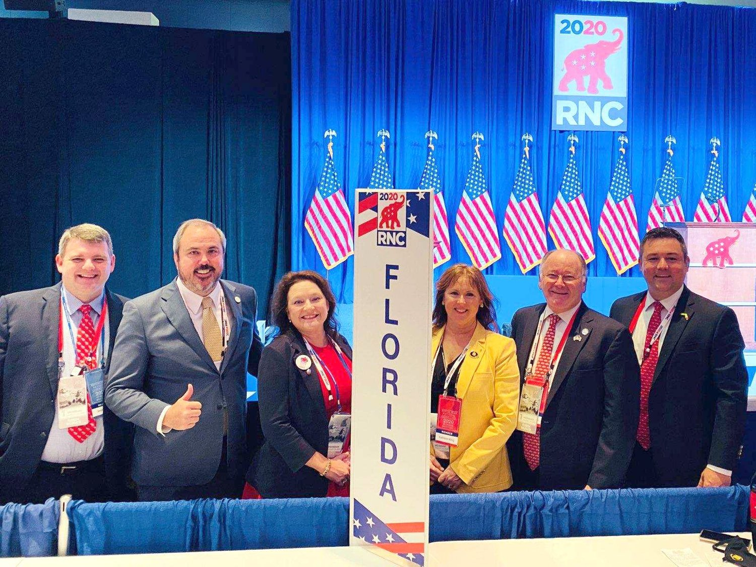 Kristy Banks, center, stands with the five other members of the Florida delegation at this week's Republican National Convention.