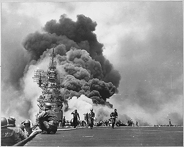 This May 11, 1945 photo shows the aircraft carrier USS Bunker Hill burning after being hit by two Japanese kamikaze attacks during the Battle of Okinawa off Kyushu. The attack killed 372 and wounded 264.