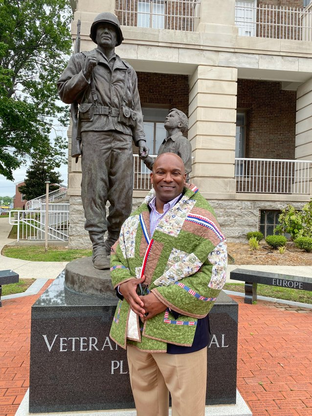 """Bedford County Economic Director Shane Hooper was recently wrapped with a Quilt of Valor for his service from 1993 to 1997 in the U.S. Marines. """"We are fortunateto have Shane working for the betterment of our community!"""" said Amy Martin, QOV representative who presented the quilt."""