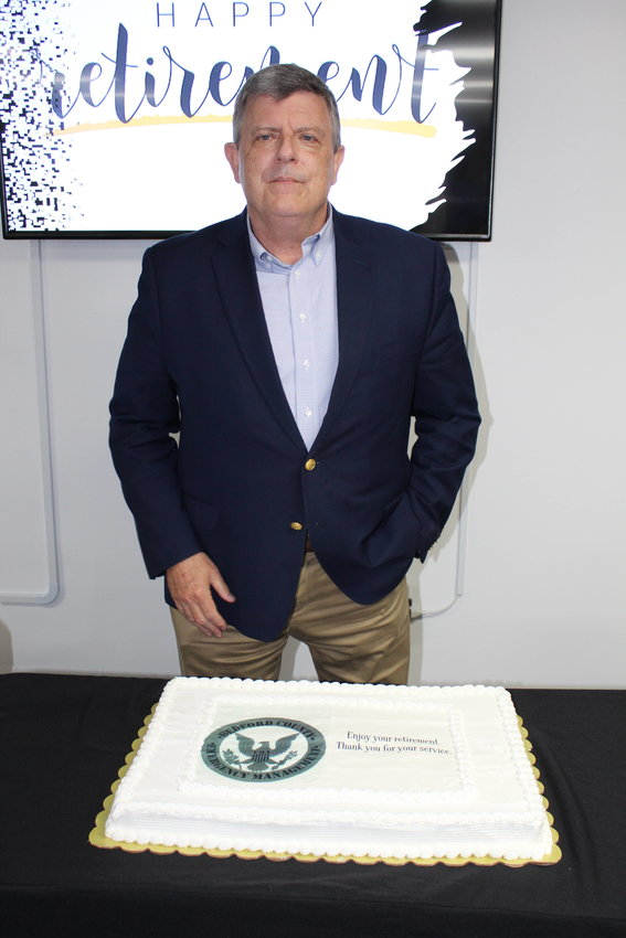 Bedford County Emergency Management Director Scott Johnson was honored at a retirement reception Friday, July 30, at the BCEMA headquarters. Following cake, Johnson spoke to those in attendance.