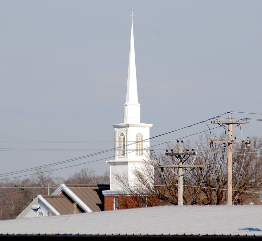 """The steeple and spire of First Christian Church on Madison Street shine bright above Shelbyville businesses. Many Protestant churches are already making plans for """"Holy Week,"""" which will be observed Monday, March 29, through Saturday, April 3. Easter or Resurrection Sunday is April 4."""