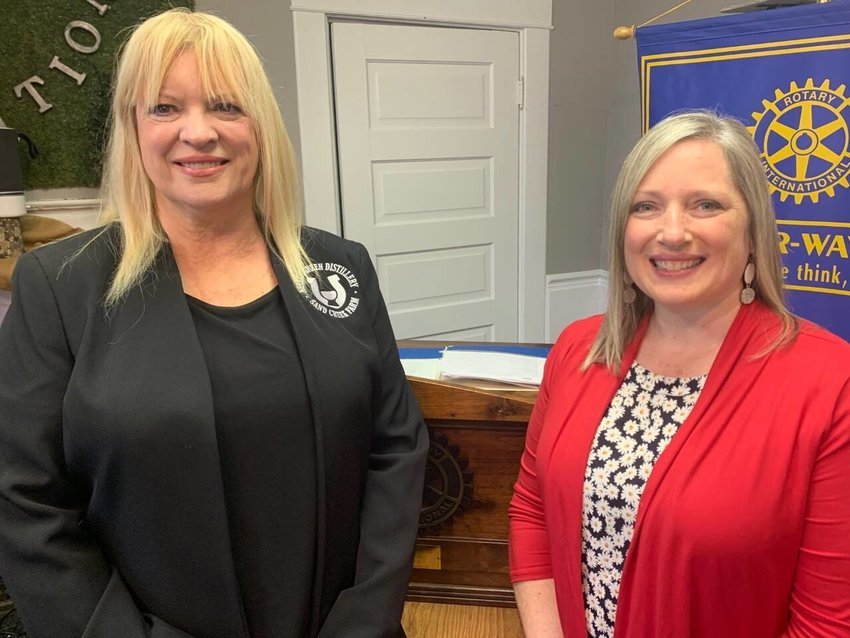 Sherrie Moore, left, director of whiskey operations for Nearest Green Distillery, recently spoke to Rotarians about the whiskey-making-process and the plans for the distillery, located at the former Sand Creek Farm. Dawn Hobbs was program facilitator.