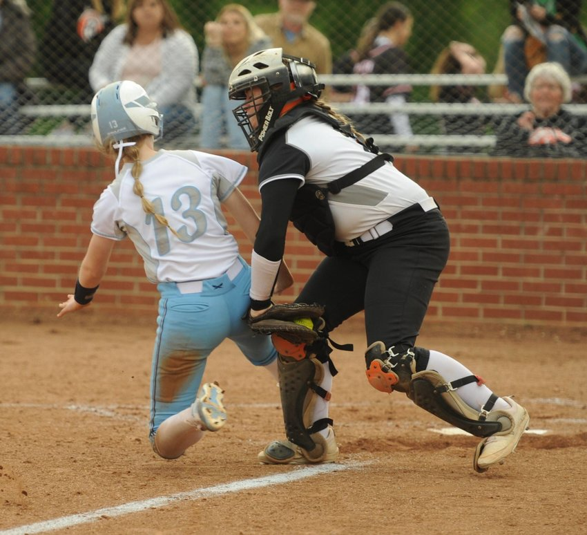 Senior catcher Cenzie McAnally makes the tag preventing a Raiderette run from scoring in the third inning.