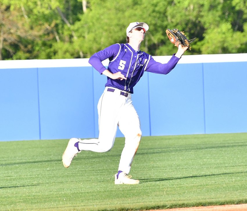 Evan Petrie of the Vikings makes the catch of a fly ball in center field.