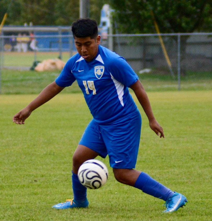 Shelbyville Central senior Jose Diomingo takes control of the ball in the Eagles district tournament win over Franklin County on Tuesday evening.