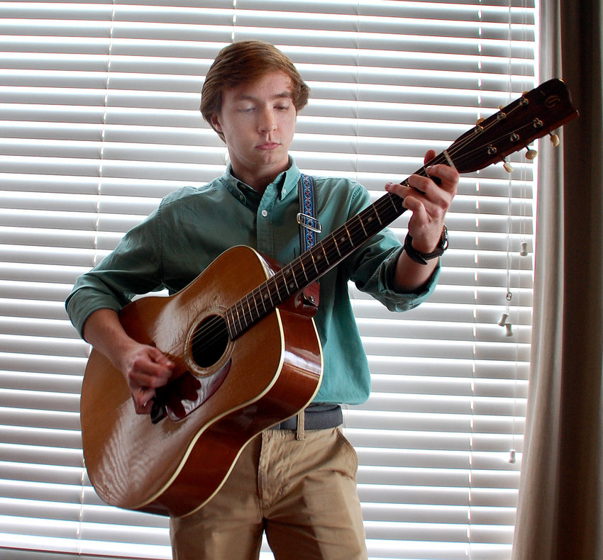 Chase Clanton used his late grandfather's guitar and dedicated the Shelbyville Woman's Club appearance to him.