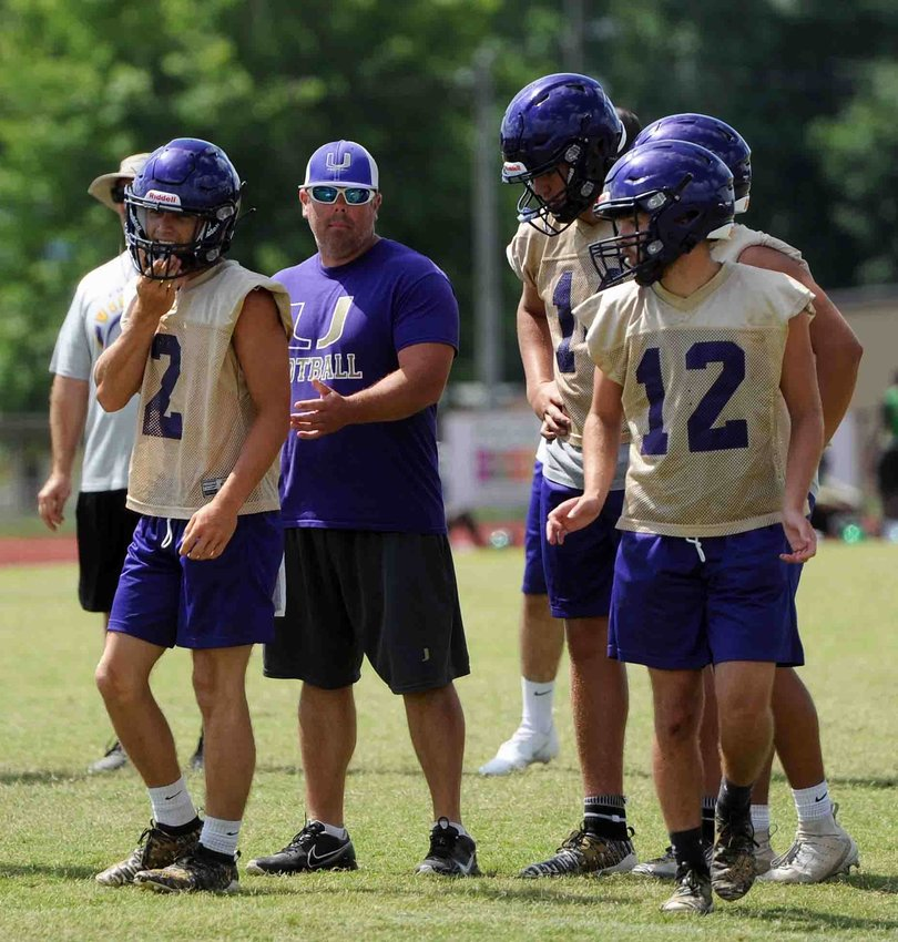 Viking coach Chris Grooms gives instruction during a 7-on-7 at Shelbyville Central.