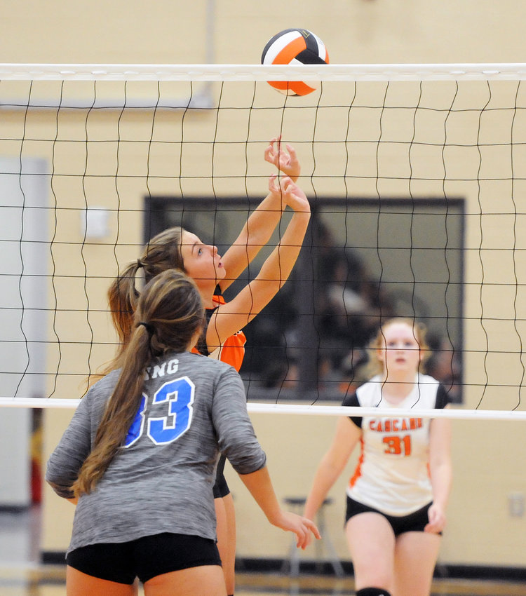 Hayden Jones sets the ball for a Lady Champion kill by Ivy Womack.